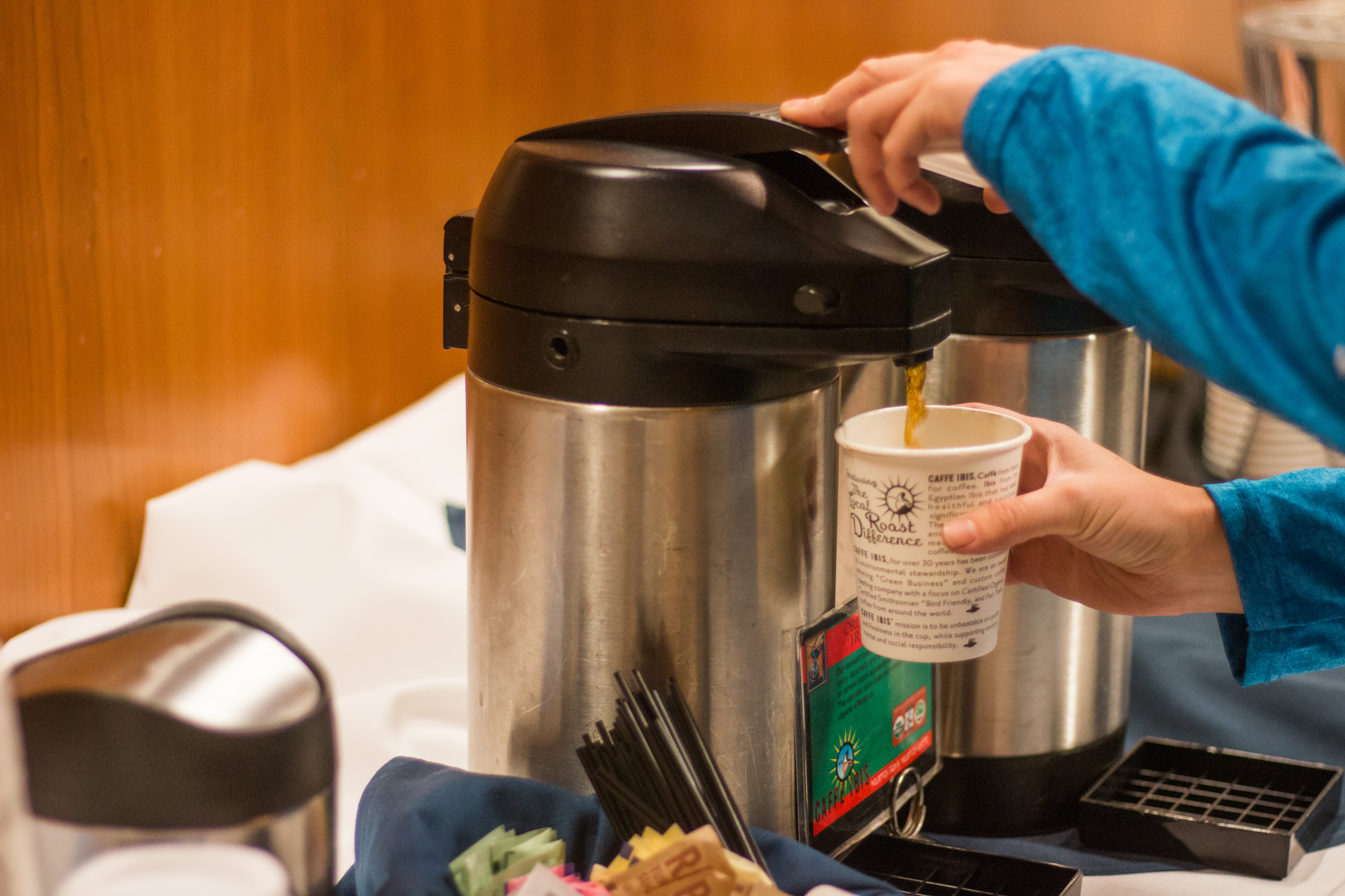 graduate student pouring coffee
