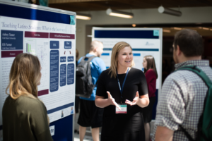 A student presents a poster at USU's Student Research Symposium